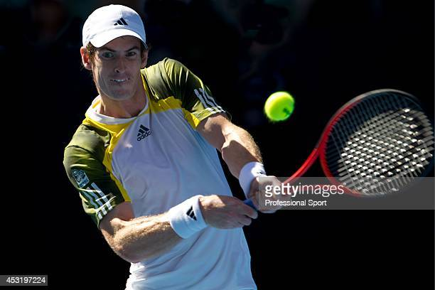 Andy Murray of Great Britain plays a backhand in his third round match against Ricardas Berankis of Lithuania during day six of the 2013 Australian...