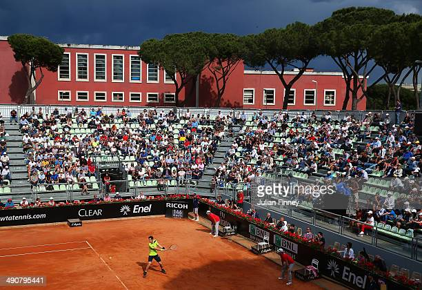 Andy Murray of Great Britain plays a backhand on the grandstand court in his match against Jurgen Melzer of Austria during day five of the...