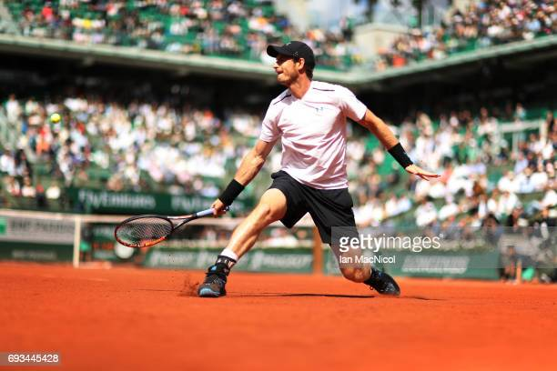 Andy Murray of Great Britain plays a backhand shot during his match with Kei Nishikori of Japan, on day eleven at Roland Garros on June 7, 2017 in...
