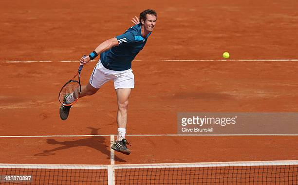 Andy Murray of Great Britain plays a backhand volley against Andreas Seppi of Italy during day two of the Davis Cup World Group Quarter Final match...