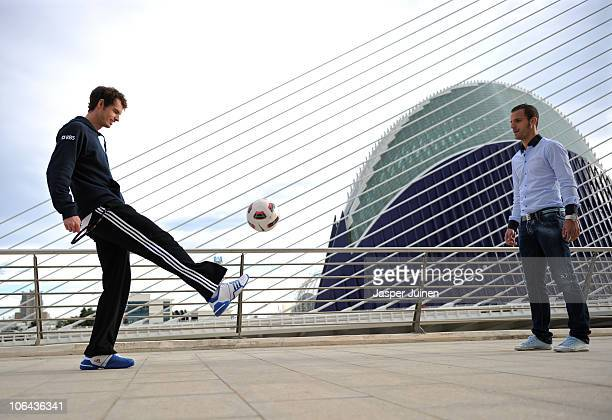 Andy Murray of Great Britain plays a ball to football player Roberto Soldado of Valencia during the ATP 500 World Tour Valencia Open tennis...