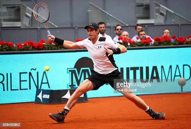 Andy Murray of Great Britain plays a forehand against Gilles Simon of France in their third round match during day six of the Mutua Madrid Open...