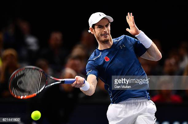 Andy Murray of Great Britain plays a forehand against John Isner of the United States during the Mens Singles Final on day seven of the BNP Paribas...
