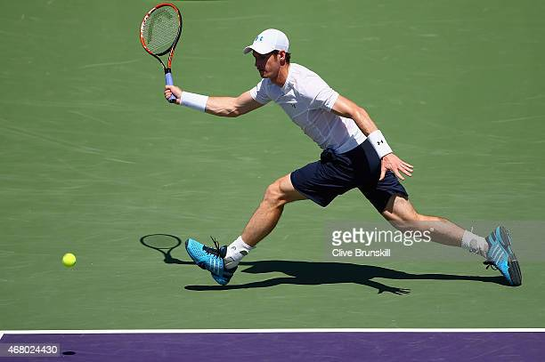 Andy Murray of Great Britain plays a forehand against Santiago Giraldo of Columbia in their third round match during the Miami Open Presented by Itau...