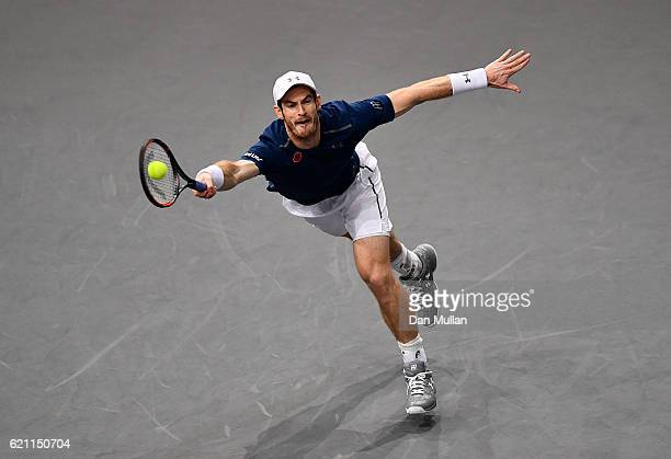 Andy Murray of Great Britain plays a forehand against Tomas Berdych of the Czech Republic during the Mens Singles quarter final match on day five of...