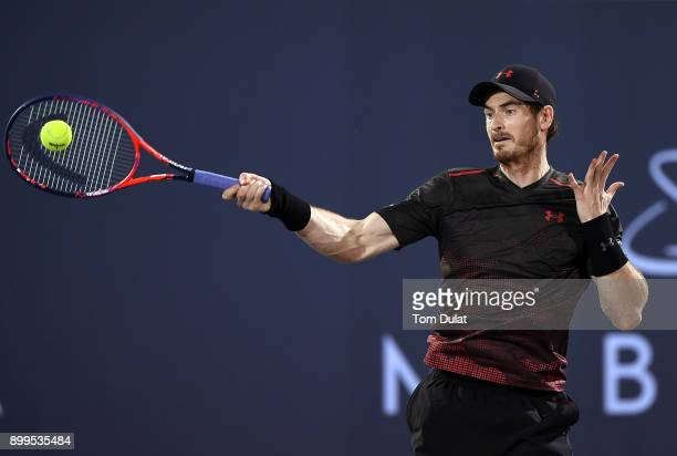 Andy Murray of Great Britain plays a forehand during his exhibition match against Roberto Bautista Agut of Spain on day two of the Mubadala World...