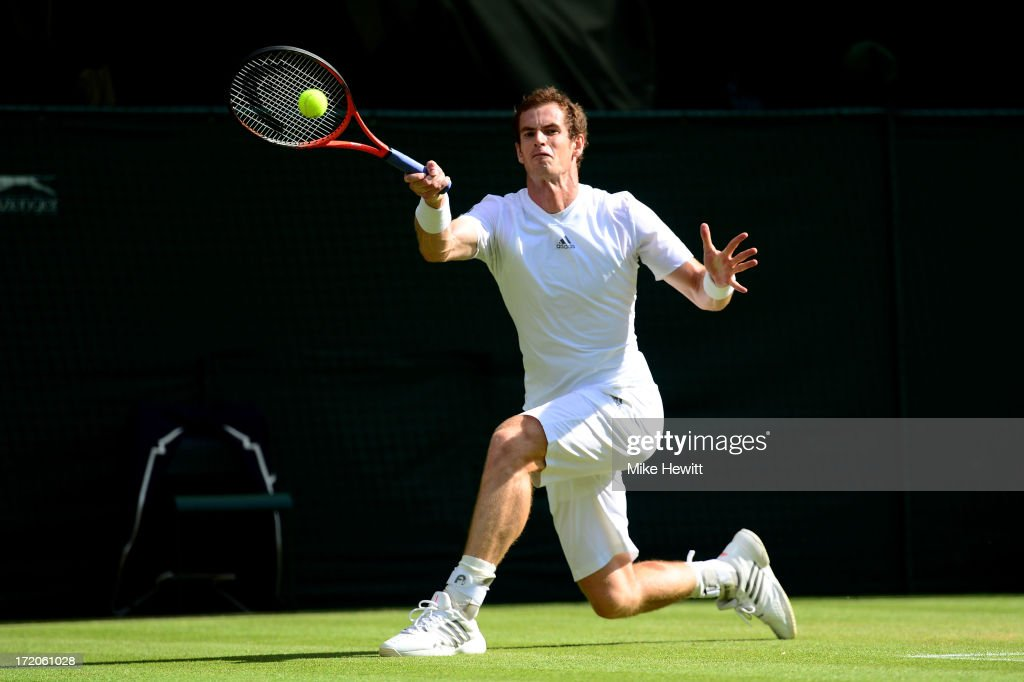 Andy Murray of Great Britain plays a forehand during the Gentlemen's Singles fourth round match against Mikhail Youzhny of Russia on day seven of the Wimbledon Lawn Tennis Championships at the All England Lawn Tennis and Croquet Club on July 1, 2013 in London, England.