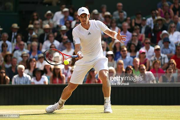 Andy Murray of Great Britain plays a forehand during the Gentlemen's Singles Final match against Novak Djokovic of Serbia on day thirteen of the...