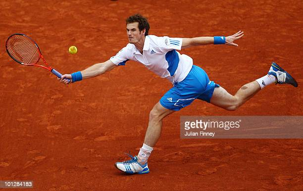 Andy Murray of Great Britain plays a forehand during the men's singles fourth round match between Andy Murray of Great Britain and Tomas Berdych of...