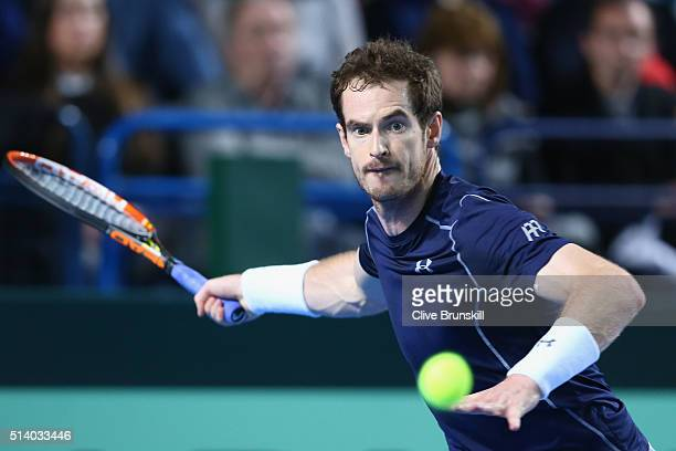 Andy Murray of Great Britain plays a forehand during the singles match against Kei Nishikori of Japan on day three of the Davis Cup World Group first...
