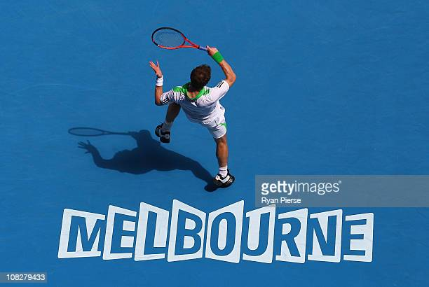 Andy Murray of Great Britain plays a forehand in his fourth round match against Jurgen Melzer of Austria during day eight of the 2011 Australian Open...