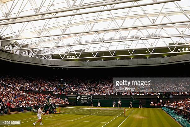 Andy Murray of Great Britain plays a forehand in his Gentlemens Singles Quarter Final match against Vasek Pospisil of Canada during day nine of the...