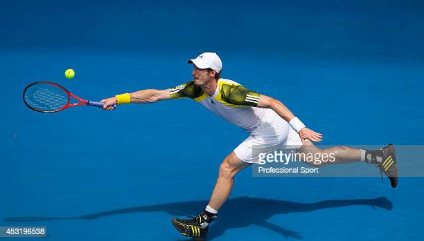 Andy Murray of Great Britain plays a forehand in his second round match against Joao Sousa of Portugal during day four of the 2013 Australian Open at...