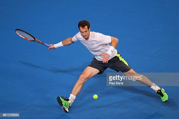Andy Murray of Great Britain plays a forehand in his singles match against Marinko Matosevic of Australia during day six of the 2015 Hopman Cup at...