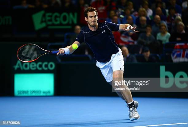 Andy Murray of Great Britain plays a forehand in his singles match against Taro Daniel of Japan during day one of the Davis Cup World Group first...