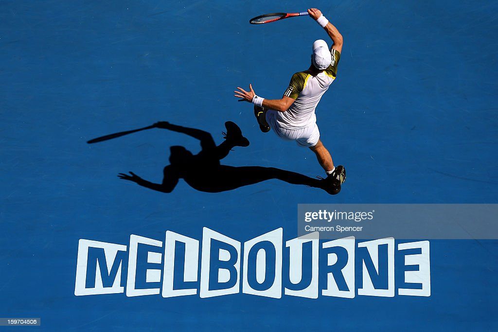 Andy Murray of Great Britain plays a forehand in his third round match against Ricardas Berankis of Lithuania during day six of the 2013 Australian Open at Melbourne Park on January 19, 2013 in Melbourne, Australia.