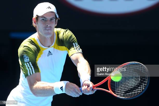 Andy Murray of Great Britain plays a forehand in hisr third round match against Ricardas Berankis of Lithuania during day six of the 2013 Australian...