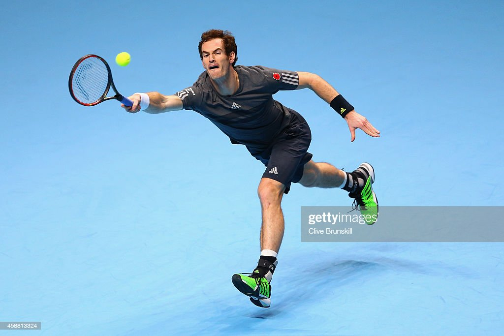 Andy Murray of Great Britain plays a forehand in the round robin singles match against Milos Raonic of Canada on day three of the Barclays ATP World Tour Finals at the O2 Arena on November 11, 2014 in London, England