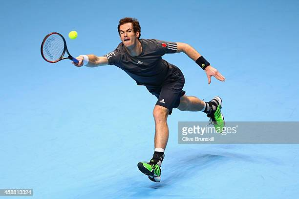 Andy Murray of Great Britain plays a forehand in the round robin singles match against Milos Raonic of Canada on day three of the Barclays ATP World...