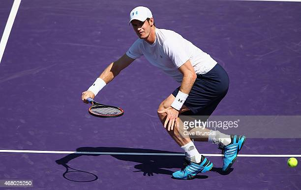Andy Murray of Great Britain plays a forehand volley against Santiago Giraldo of Columbia in their third round match during the Miami Open Presented...