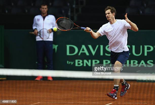 Andy Murray of Great Britain plays a forehand watched by his captain Leon Smith during a practice session ahead of the start of the Davis Cup Final...