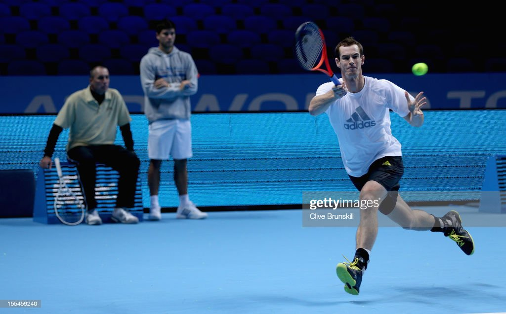 Andy Murray of Great Britain plays a forehand watched by his coach Ivan Lendl and hitting partner Daniel Vallverdu during a practice session prior to the start of ATP World Tour Finals Tennis at the O2 Arena on November 4, 2012 in London, England.