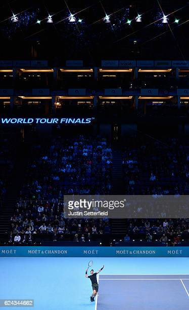 Andy Murray of Great Britain plays a serve during his men's singles semi final against Milos Raonic of Canada on day seven of the ATP World Tour...