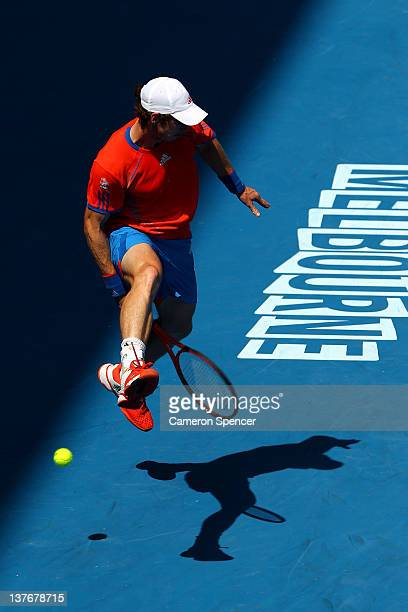Andy Murray of Great Britain plays a shot through his legs in his quarterfinal match against Kei Nishikori of Japan during day ten of the 2012...