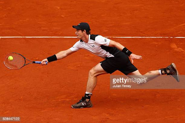 Andy Murray of Great Britain plays a volley in his match against Gilles Simon of France during day six of the Mutua Madrid Open tennis tournament at...