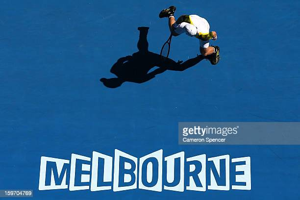 Andy Murray of Great Britain plays backhand in his third round match against Ricardas Berankis of Lithuania during day six of the 2013 Australian...