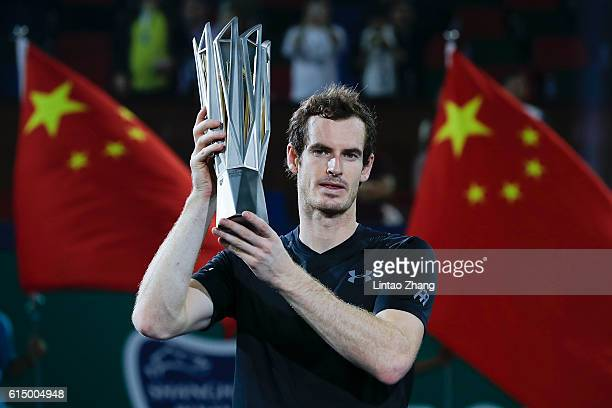 Andy Murray of Great Britain pose with trophy after winning his men's singles final match against Roberto Bautista Agut of Spain on day eight of...