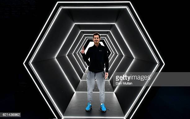 Andy Murray of Great Britain poses after winning the Mens Singles Final against John Isner of the United States on day seven of the BNP Paribas...