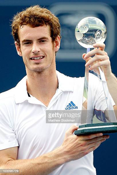 Andy Murray of Great Britain poses for photographers after defeating Roger Federer of Switzerland during the final of the Rogers Cup at the Rexall...