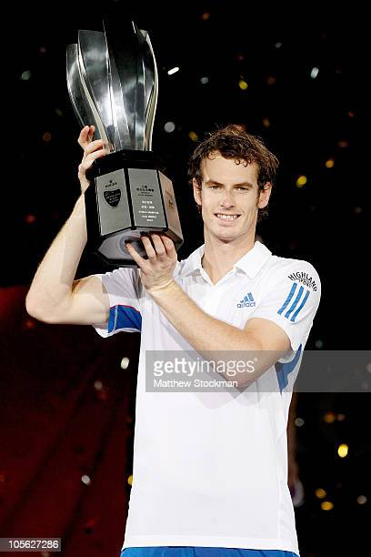 Andy Murray of Great Britain poses for photographers after defeating Roger Federer of Switzerland during the final on day seven of the 2010 Shanghai...