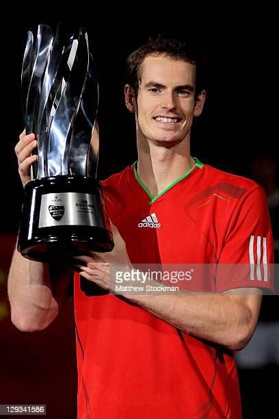 Andy Murray of Great Britain poses for photographers after defeating David Ferrer of Spain during the final of the Shanghai Rolex Masters at the Qi...