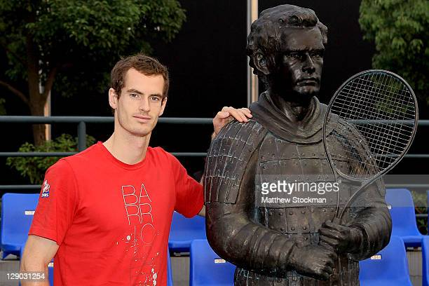 Andy Murray of Great Britain poses for photographers at the unvieling of a statue of his likeness as a terra cotta warrior during the Shanghai Rolex...
