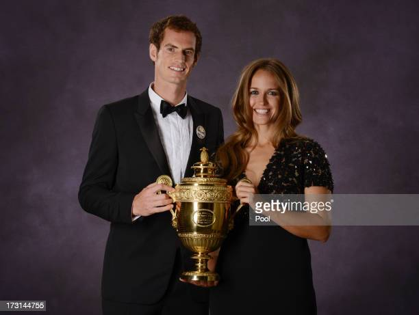 Andy Murray of Great Britain poses his poses with his girlfriend Kim Sears and the Gentlemen's Singles Trophy at the Wimbledon Championships 2013...