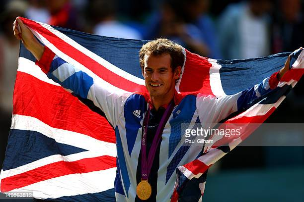 Andy Murray of Great Britain poses with his gold and silver medals holding a union jack after the medal ceremony for the Mixed Doubles Tennis on Day...