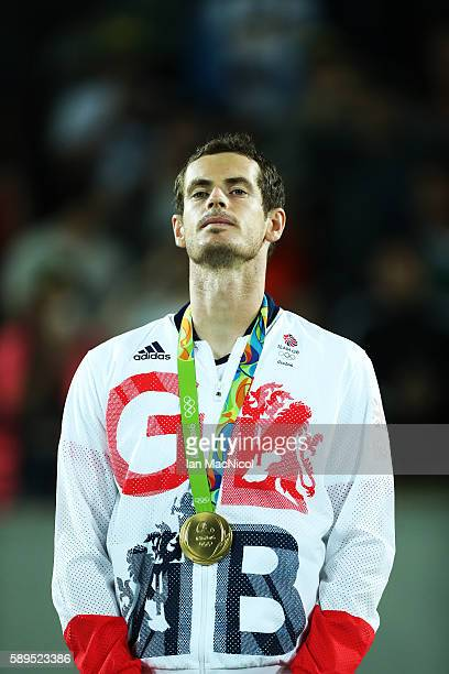 Andy Murray of Great Britain poses with his Gold medal after defeating Juan Martin del Potro of Argentina in the Men's singles final at Olympic...
