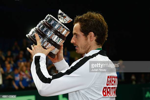 Andy Murray of Great Britain poses with his trophy following victory on day three of the Davis Cup Final 2015 at Flanders Expo on November 29 2015 in...
