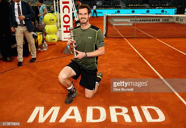 Andy Murray of Great Britain poses with his winners trophy after his straight sets victory against Rafael Nadal of Spain in the mens final during day...