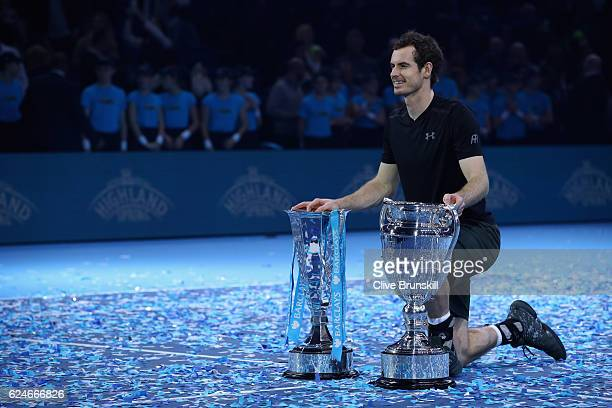 Andy Murray of Great Britain poses with the ATP Tour Finals trophy and the Year end World number one trophy following his victory during the Singles...