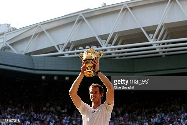 Andy Murray of Great Britain poses with the Gentlemen's Singles Trophy following his victory in the Gentlemen's Singles Final match against Novak...