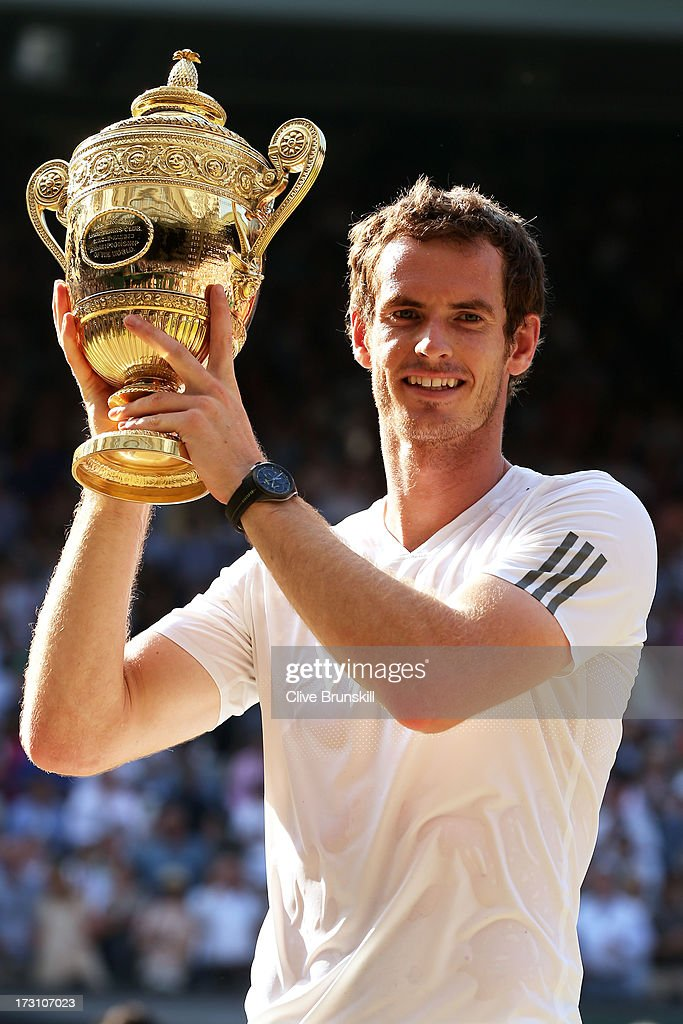 Andy Murray of Great Britain poses with the Gentlemen's Singles Trophy following his victory in the Gentlemen's Singles Final match against Novak Djokovic of Serbia on day thirteen of the Wimbledon Lawn Tennis Championships at the All England Lawn Tennis and Croquet Club on July 7, 2013 in London, England.