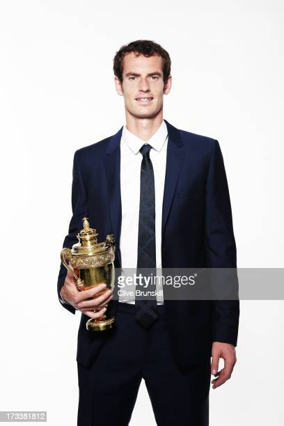 Andy Murray of Great Britain poses with the Gentlemen's Singles Trophy during an exclusive photo shoot following his victory in the Wimbledon...