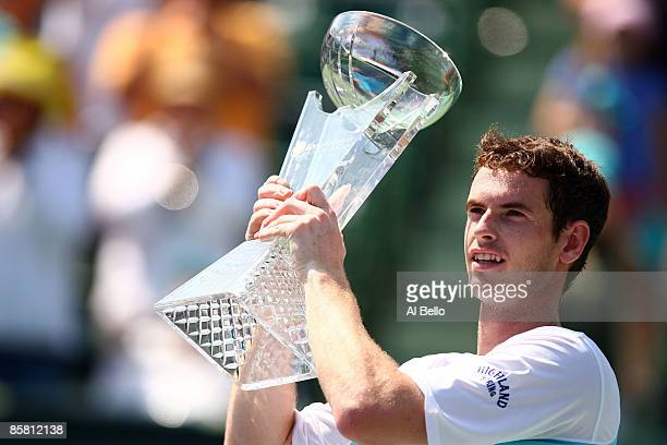 Andy Murray of Great Britain poses with the trophy after defeating Novak Djokovic of Serbia to win the men's final of the Sony Ericsson Open at the...