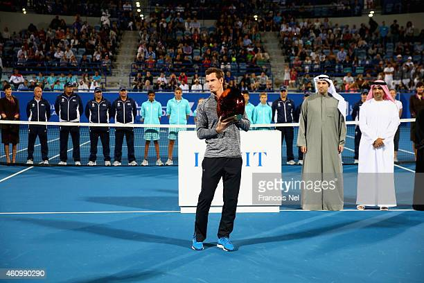 Andy Murray of Great Britain poses with the trophy after winning the the Mubadala World Tennis Championship at Zayed Sport City on January 3 2015 in...