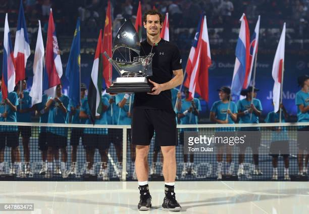 Andy Murray of Great Britain poses with the trophy after winning the final match against Fernando Verdasco of Spain on day seven of the ATP Dubai...