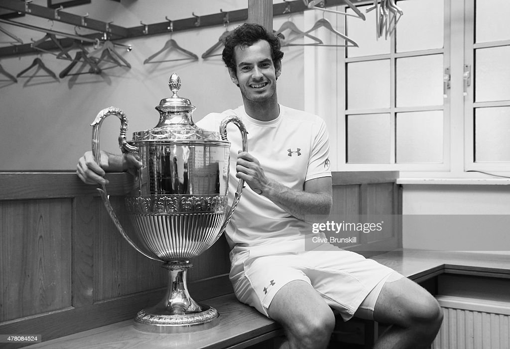 Image has been converted to black and white) Andy Murray of Great Britain poses with the trophy in the dressing room after his victory in the men's singles final match against Kevin Anderson of South Africa during day seven of the Aegon Championships at Queen's Club on June 21, 2015 in London, England.