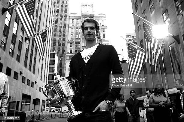 Andy Murray of Great Britain poses with the US Open Championship trophy following an interview on the NBC Today Show during a New York City trophy...